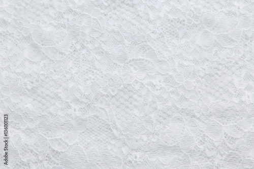 Valokuvatapetti White lace with small flowers on the white background.