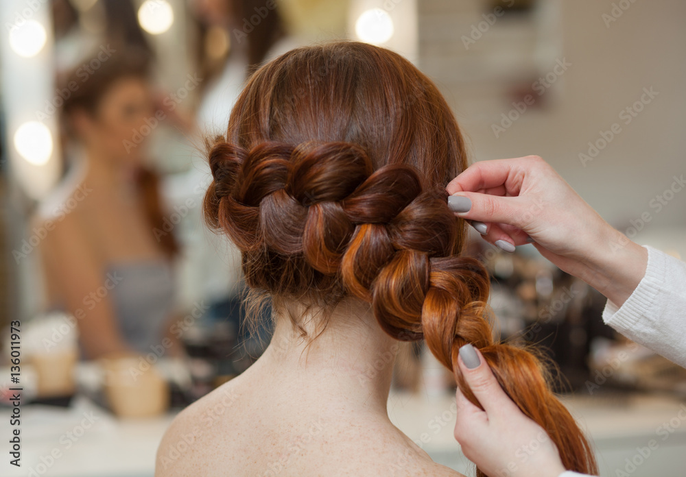 Fototapety, obrazy: Beautiful, with long, red-haired hairy girl, hairdresser weaves a French braid, close-up in a beauty salon. Professional hair care and creating hairstyles.