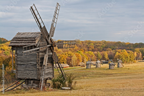 Old wooden windmill in the countryside in autumn season