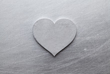 Silver Heart On Scratched Meta...