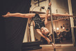 Cute little girl performing pole dance on pole