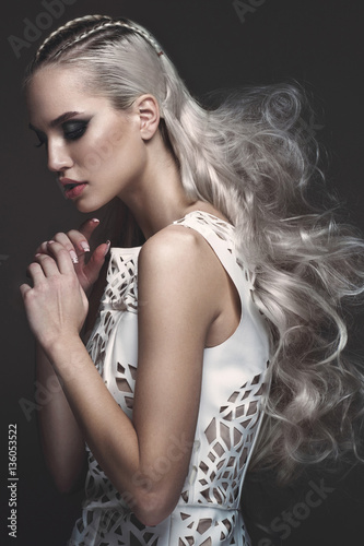 Beautiful girl in art dress with avant-garde hairstyles. Beauty the ...