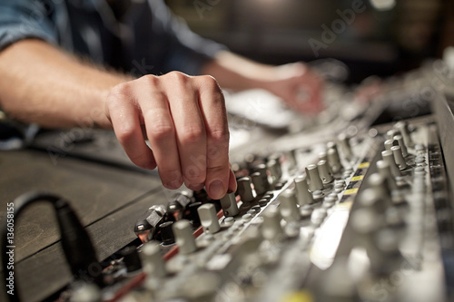Photo  man using mixing console in music recording studio