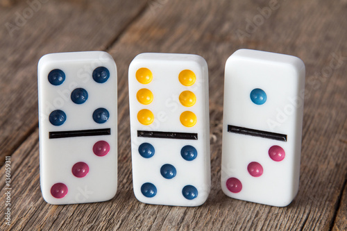 Three dominoes with colorful dots Obraz na płótnie