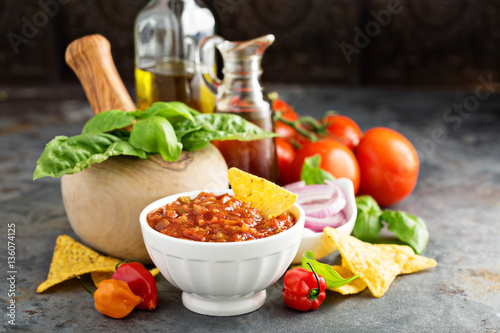 Tuinposter Canarische Eilanden Homemade spicy tomato salsa with vegetables and olive oil