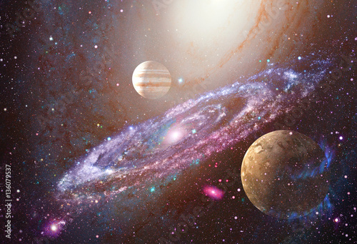 Spiral galaxy and planet in outer space