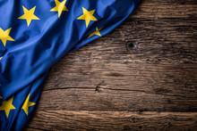 Flag Of Europe Union On Old Wooden Background. EU Flag Old Oak Background.