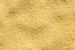 Backgroung of dry cornmeal polenta from above.
