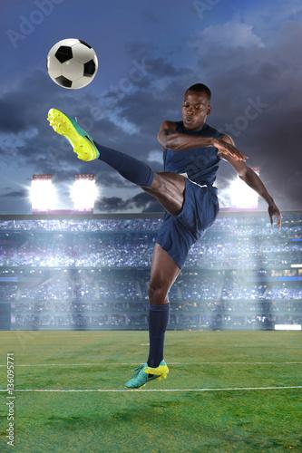 Staande foto Voetbal Soccer Player Kicking Ball