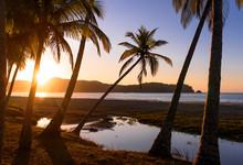 A Sunset On A Beach In Costa Rica