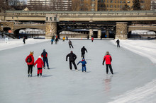 People Ice Skating On The Rideau Canal, Ottawa For Winterlude.