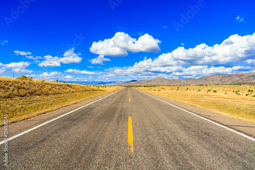 Photo Stands Dark blue Rural two lane highway in New Mexico.
