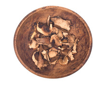 Dried Porcini Mushroom In Wooden Bowl Isolated On White Background