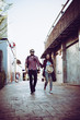 Portrait of hipster couple walking in the street urban.