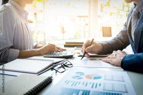 Fotografía  business man financial inspector and secretary making report, ca