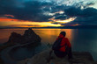 Man admiring the sunset at Cape Burhan on Olkhon