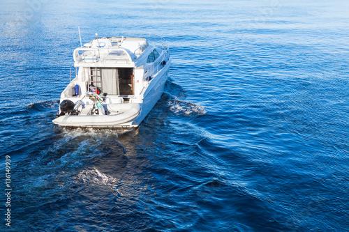 Stampa su Tela Small white pleasure motorboat