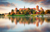 Wawel hill with castle in pink light of sunset, Krakow, Poland - 136150545