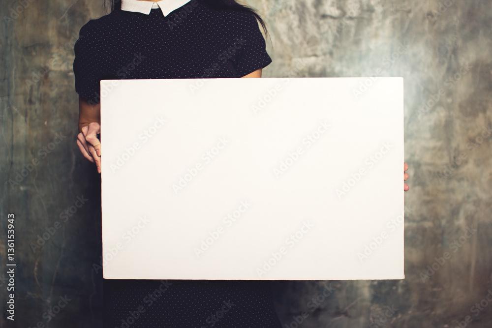 Fototapety, obrazy: Girl in dress posing with white canvas. Horizontal mockup