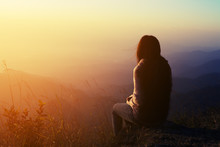 Silhouette Woman Sitting On Mountain In Morning