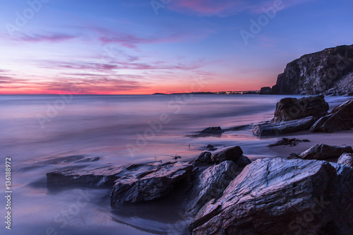 Sunset on beach at Watergate Bay, Cornwall, England Fototapeta