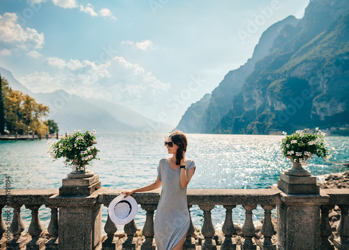 Stampa su Tela Young beautiful woman relaxing on picturesque Garda Lake