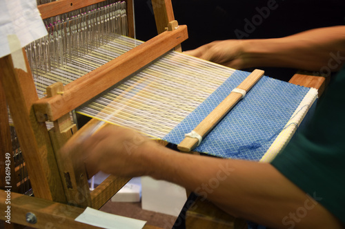 Fotografie, Obraz  Thai people using small loom or weaving machine for weaving show