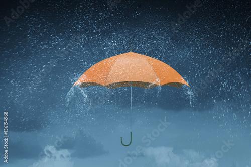 Photo  Color umbrella in sky . Mixed media