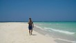 Man talking on the mobile phone at the beach. Man talking on cell phone and walking along beach. Beach, sea, sand,wave. Philippines, Travel concept. 4K video