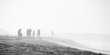 Beach Scene In Black And White With Mist And People, Grain Is In