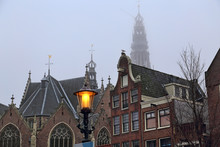 Old Church And Historical Houses In Amsterdam