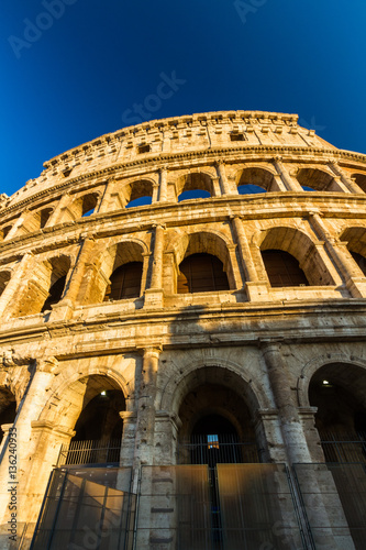 Fotografia, Obraz  Colosseum or Coliseum Amphitheatre, evening in Rome.