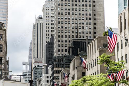 Foto op Plexiglas New York TAXI American flag New York City USA Buildings facade Big Apple
