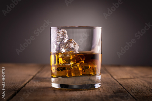 Foto op Plexiglas Bar Glass of whiskey, classy, with ice, on wooden table