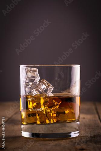 Foto op Plexiglas Bar Glass of whiskey on wooden table