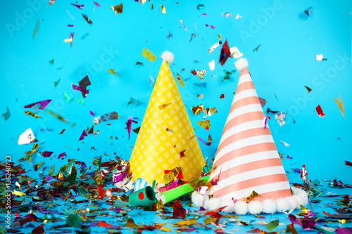 Photo Stands Indians Party hats with colorful confetti on color background