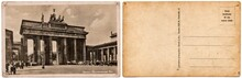 Vintage Postcard With A Picture Of The Old Architecture, The Brandenburg Gate In Berlin, Germany, In 1935. Isolated On A White Background. The Front And Back Side.