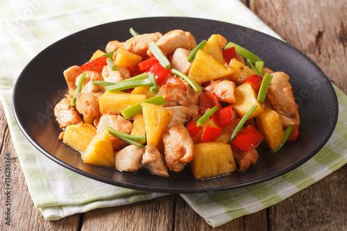 roasted chicken breast with pineapple and vegetables in sweet and sour sauce. horizontal