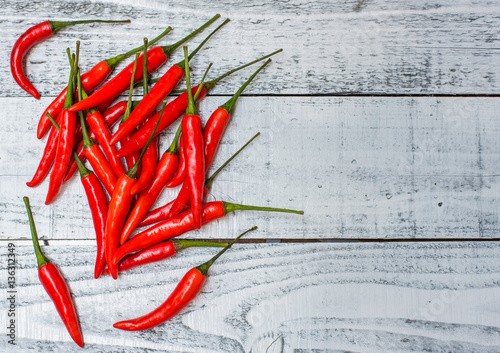 Photo  Hot and spicy red chilli on wood table background