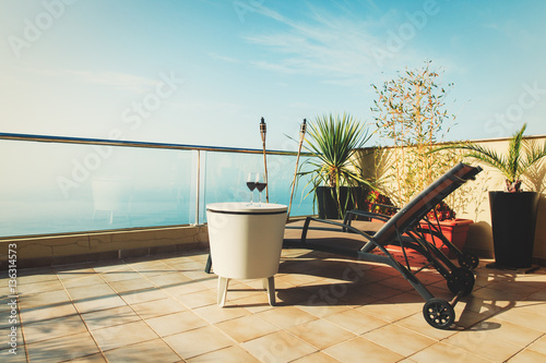 luxury terrace balcony for relaxed vacation at sea Wallpaper Mural
