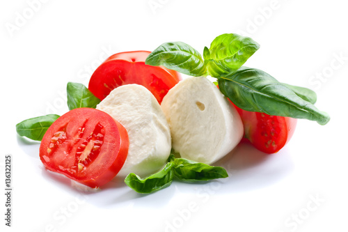 Fényképezés  mozzarella with tomato and basil isolated on white