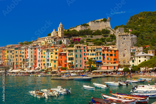 Colorful picturesque harbour of Porto Venere, San Lorenzo church and Doria Castle on the background, La Spezia, Liguria, Italy.