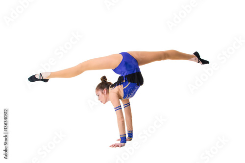 Spoed Foto op Canvas Gymnastiek Young girl doing gymnastic exercises isolated