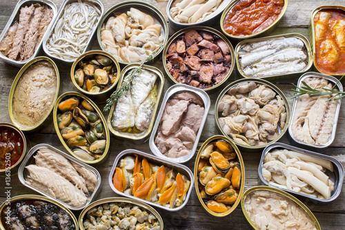 Fotomural Assortment of cans of canned with different types of fish and seafood,