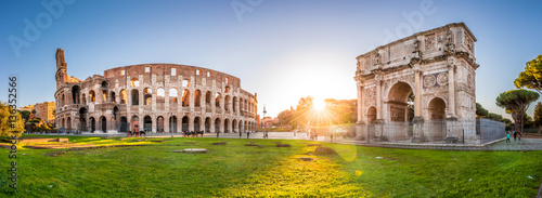 Poster Rome Panoramic view of Colosseum and Constantine arch at sunrise. Rome, Italy