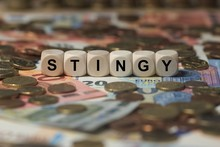 Stingy - Cube With Letters, Money Sector Terms - Sign With Wooden Cubes