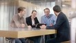 Businessgroup discusses a new project in office on a tablet
