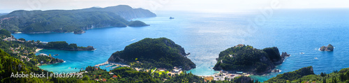 Wall Murals New Zealand Beautiful summer panoramic seascape. View of the coastline into the sea bays with crystal clear azure water. In the backlight sunbeam light. Paleokastrica. Corfu. Ionian archipelago. Greece.