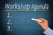 Workshop Agenda with Checklist on blue chalkboard background with female hand and chalk