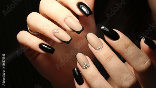 Youth manicure design, color coffee with rhinestones and black